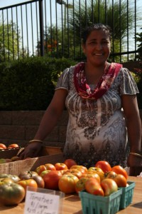 global greens - woman and produce - transformational generosity