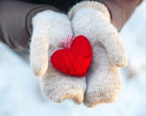 mitten hands holding heart