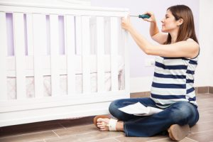 Pregnant woman with crib