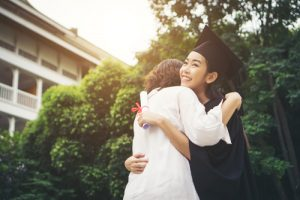graduate hugging her mother